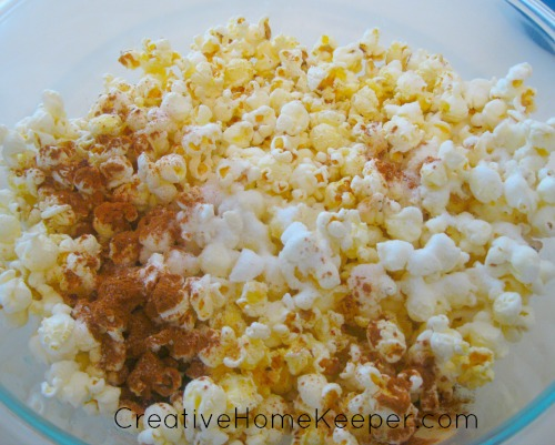 This sweet and savory popcorn recipe combines the sweet flavors of sugar and cinnamon with the savory flavors of butter and salt. This snack is sure to be a delicious hit with your family. | CreativeHomeKeeper.com