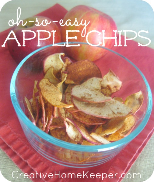 These apple chips are Oh-So-Easy to make up and delicious too! Only two ingredients, they are the PERFECT way to enjoy fall's perfect in-season fruit. Plus they store well in an air tight container... if they make it that long! Incredibly addicting, the whole family will LOVE them!!! | CreativeHomeKeeper.com