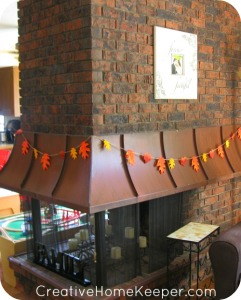 Add a little warmth and a touch of fall to your home with this simple DIY twine and leaf garland. Only a few supplies needed, this makes for an easy and frugal family friendly fall craft.   CreativeHomeKeeper.com