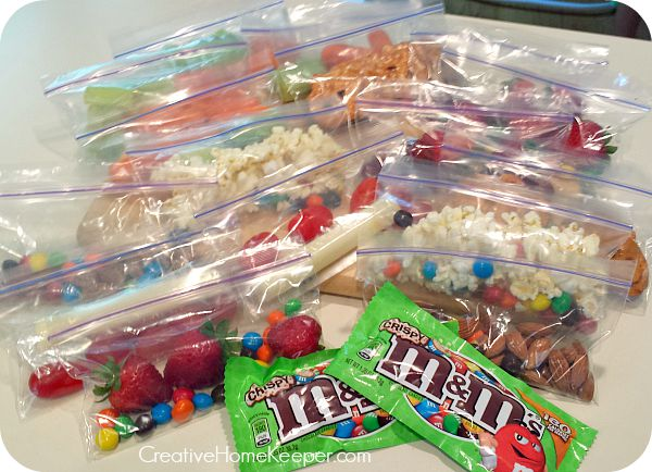 Perfect for on the go, these quick and easy to assemble snack baggies are filled with healthy, delicious, crunchy and salty snacks to fuel you for the day, including sweet treats too!